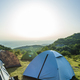 Many tents in the mountain. Sunshine morning in the forest. - PhotoDune Item for Sale