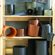 Many rolls leather on shelf in leather workshop. - PhotoDune Item for Sale