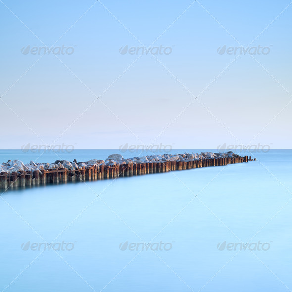 River estuary breakwater jetty seascape. Long exposure. - Stock Photo - Images