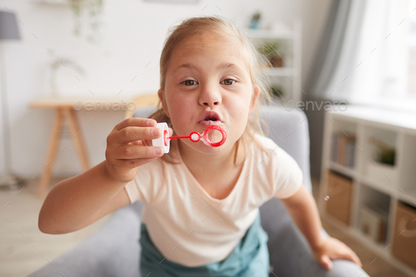 Girl playing with bubbles - Stock Photo - Images