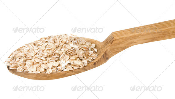 oatmeal cereals in spoon isolated on whit - Stock Photo - Images