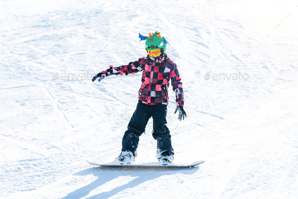 Cute Boy Having Fun, Snowboarding in the Mountains - Stock Photo - Images