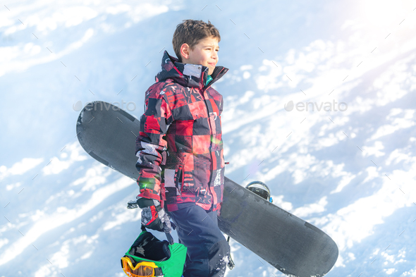 Boy with Snowboard in the Mountain Winter Resort - Stock Photo - Images