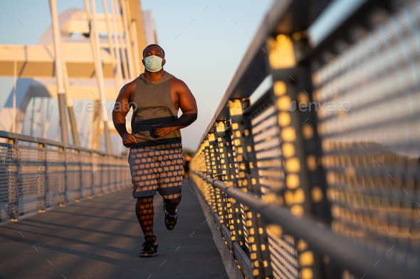 Man jogging with face mask - Stock Photo - Images