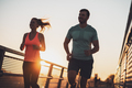 Happy couple jogging in sunset - PhotoDune Item for Sale