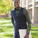 Handsome young black student holding laptop on a school campus - PhotoDune Item for Sale