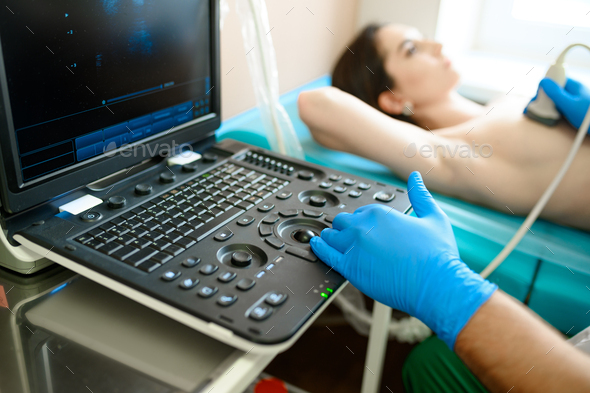 A mammologist makes breast ultrasound scanning - Stock Photo - Images
