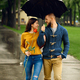 Romantic couple with umbrella walking in park - PhotoDune Item for Sale