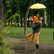Happy love couple embracing in summer rainy day - PhotoDune Item for Sale