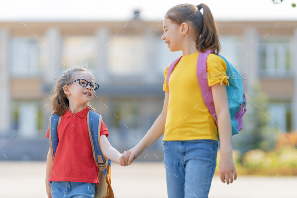 Girls with backpack are going to school - Stock Photo - Images