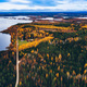 Aerial view of rural road with red car in yellow and orange autumn forest with blue lake - PhotoDune Item for Sale
