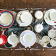 Top view of various tea cups and saucers on wooden table - PhotoDune Item for Sale