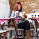 Happy young woman with Basset Hound smelling coffee at cafe table - PhotoDune Item for Sale