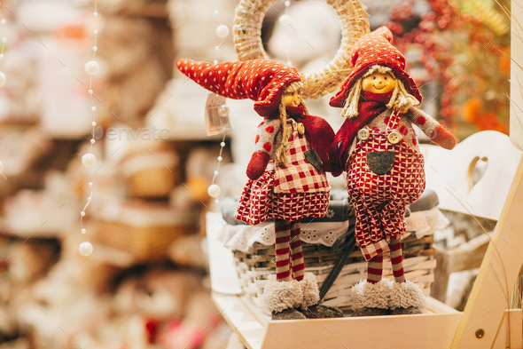 Rustic christmas toys on window in european city street. - Stock Photo - Images