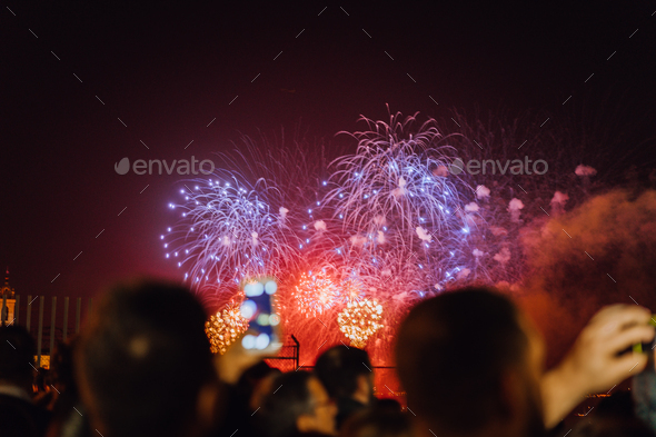 People watching fireworks and celebrating New Year - Stock Photo - Images