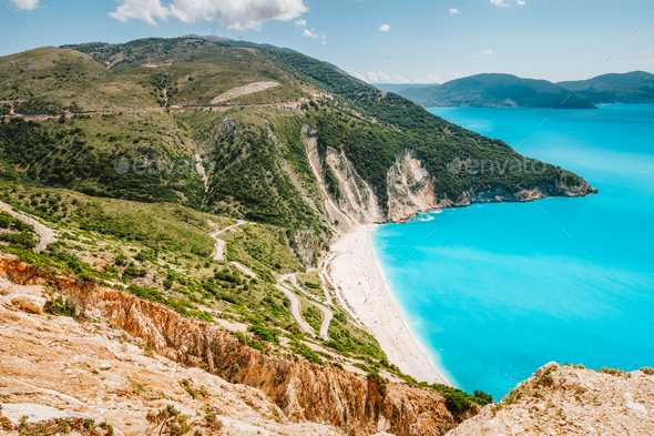 Famous Myrtos Beach at sunny summer day. Tourism visiting destination on Kefalonia island, Greece - Stock Photo - Images