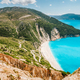 Famous Myrtos Beach at sunny summer day. Tourism visiting destination on Kefalonia island, Greece - PhotoDune Item for Sale