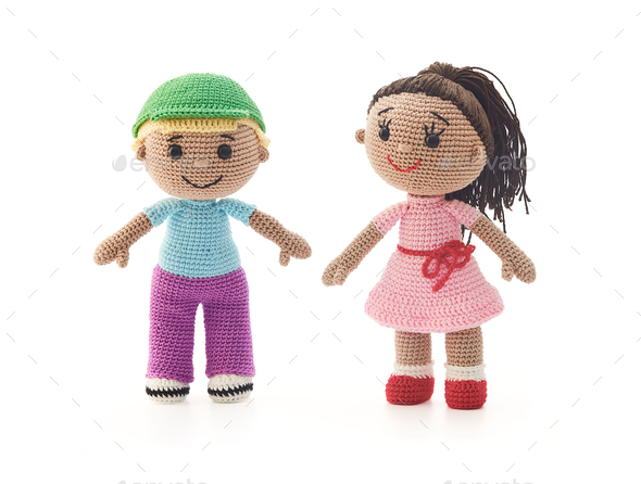 Knitted toys boy and girl on a white background - Stock Photo - Images