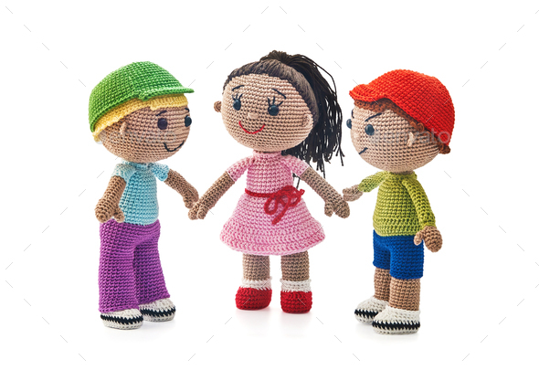 Knitted toys boys and girl on a white background - Stock Photo - Images