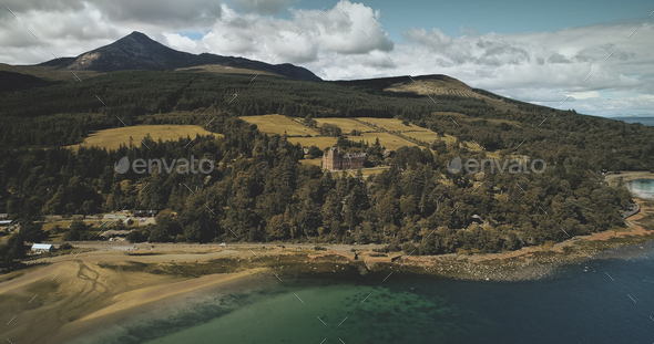 Scotland's ocean coast landscape aerial view: forests, valley, hills. Brodick castle in Arran - Stock Photo - Images