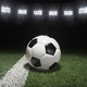 Soccer ball on field with strip under lights at night - PhotoDune Item for Sale