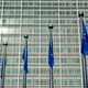 EU European Union flags in front of European Comission building in Background. Brussles, Belgium - PhotoDune Item for Sale