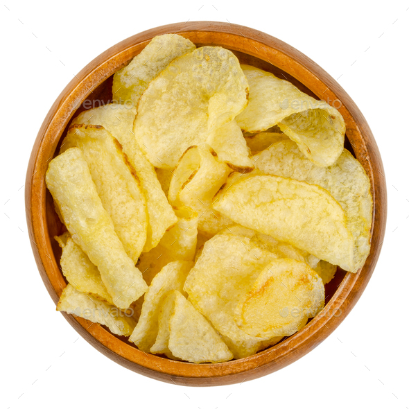 Salted potato chips with peel, also crisps, in wooden bowl - Stock Photo - Images