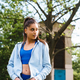 Fitness young woman posing on camera in the park - PhotoDune Item for Sale