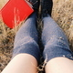 Young woman legs near a red book - PhotoDune Item for Sale