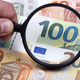 European money in a magnifying glass - PhotoDune Item for Sale