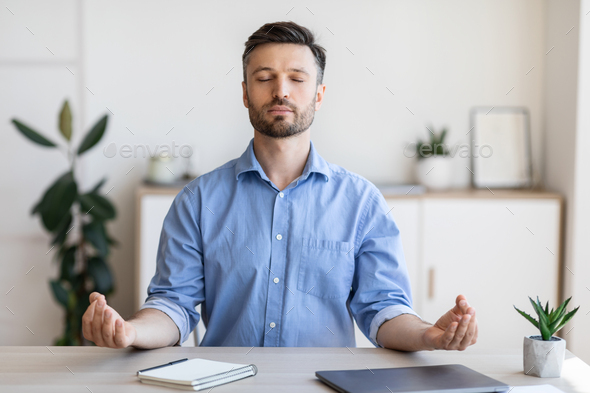 Office Zen. Relaxed Male Entrepreneur Meditating At Workplace, Coping With Stress At Work, Sitting At Desk With Eyes Closed, Free Space
