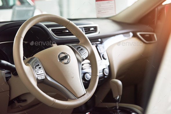 Luxury car Interior - steering wheel, shift lever and dashboard - Stock Photo - Images