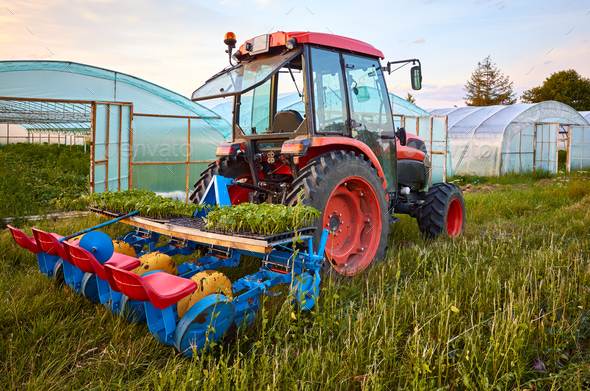 Manual seedling planter mounted to a tractor. - Stock Photo - Images
