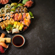 Assorted sushi set served on dark dark background. Top view of seafood, various maki rolls - PhotoDune Item for Sale