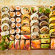 Above view of various sushi and rolls placed on wooden board. Japanese food fest - PhotoDune Item for Sale