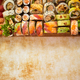 Wooden board with assortment of various kinds of sushi rolls. Japanese food concept - PhotoDune Item for Sale
