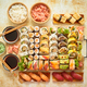 Top view background with set of colorful different kinds of sushi rolls placed on wooden board - PhotoDune Item for Sale