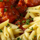 Meatballs in tomato sauce with small penne pasta - PhotoDune Item for Sale