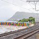 Multi-colored beach huts at St. James with railroad passing by - PhotoDune Item for Sale