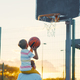 Father and son playing basketball at sunset - PhotoDune Item for Sale