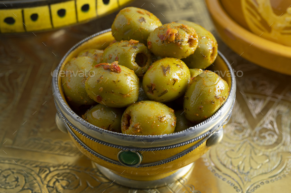 Traditional spicy Moroccan olives in a bowl - Stock Photo - Images
