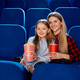 Mother spending time with daughter in cinema - PhotoDune Item for Sale