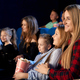 Mother watching movie with daughter in cinema - PhotoDune Item for Sale