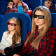 Mother wattching cartoon with daughter in cinema - PhotoDune Item for Sale