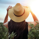 Girl in hat looking into the sun. Country Life. Prairies - PhotoDune Item for Sale