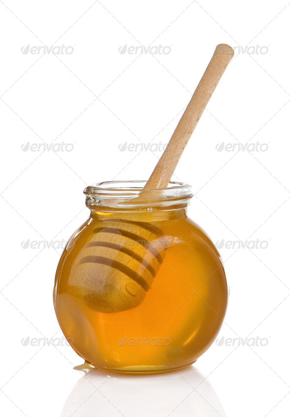 glass pot full of honey and stick isolated on white - Stock Photo - Images