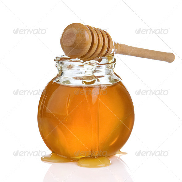 glass jar of honey and stick isolated on white - Stock Photo - Images