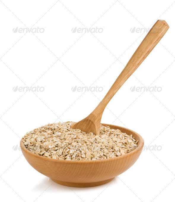 cereals flake in wood plate on white - Stock Photo - Images