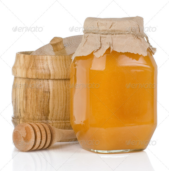 glass and wooden jars full of honey isolated on white - Stock Photo - Images