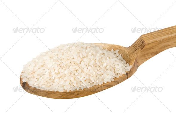 raw rice seed in wooden spoon isolated on white - Stock Photo - Images